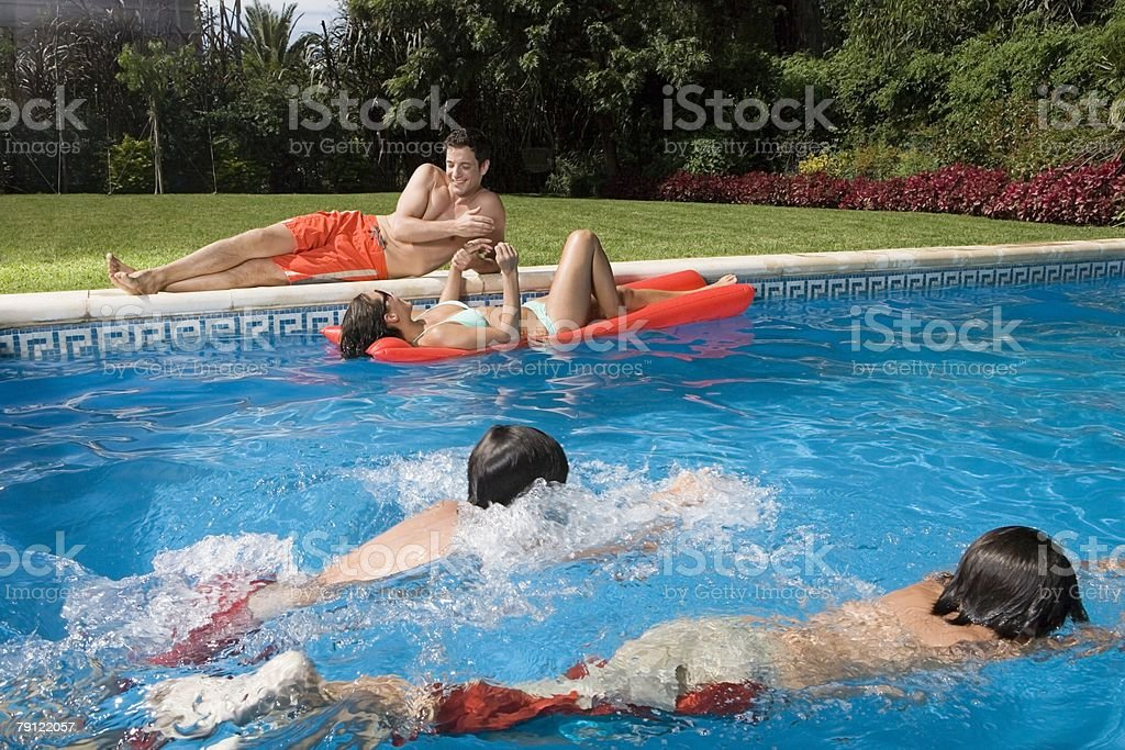 Family at swimming pool royalty-free stock photo