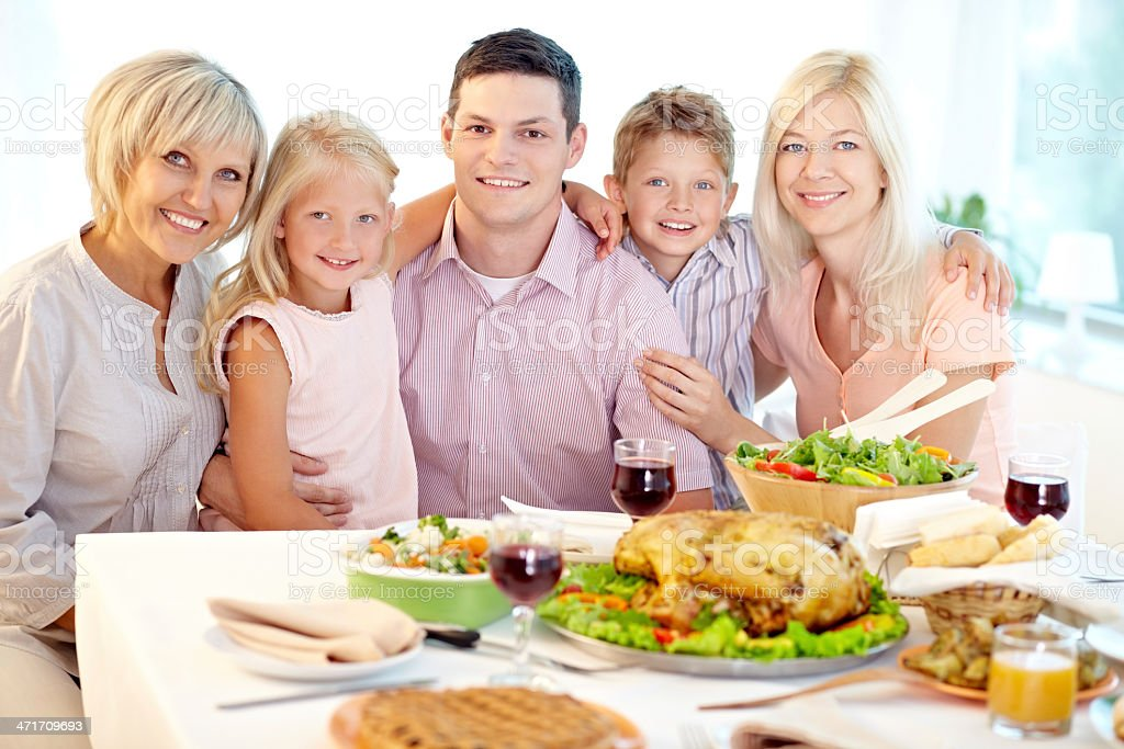 Family at Thanksgiving table royalty-free stock photo