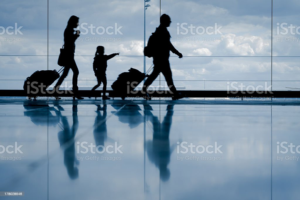 Family at the airport stock photo