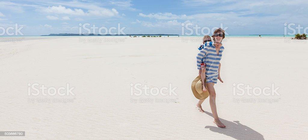 family at the beach stock photo