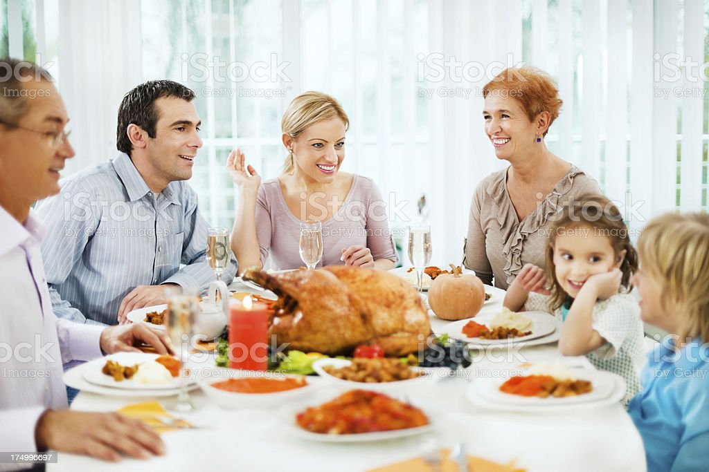 Family at the dinner table for Thanksgiving day. royalty-free stock photo