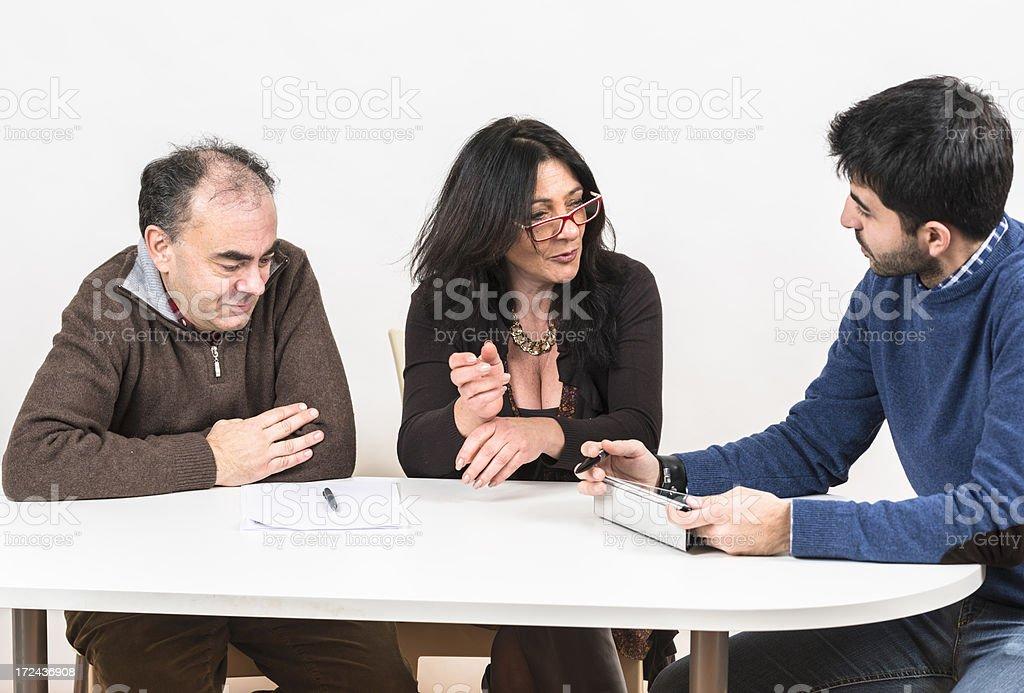 Family at the financial advisor royalty-free stock photo