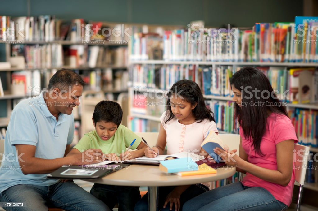 Family at the library. royalty-free stock photo