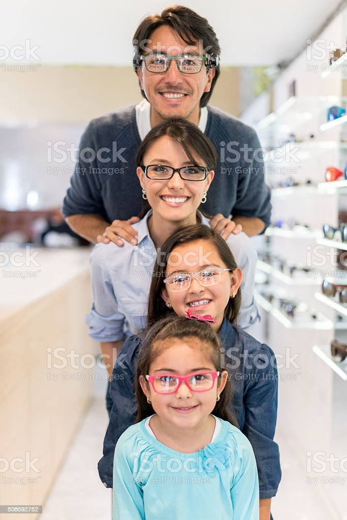Family at the optics wearing glasses stock photo