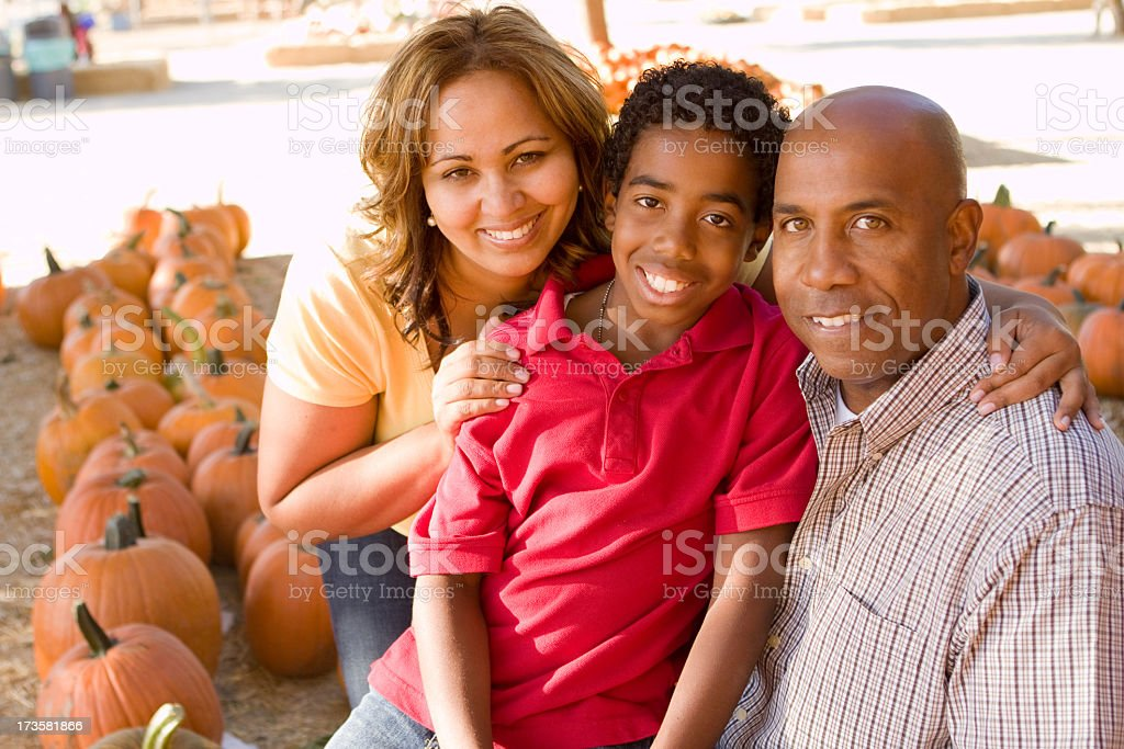 Family at the pumpkin patch royalty-free stock photo