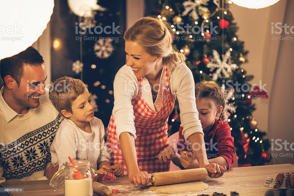 Family baking cookies for Christmas stock photo