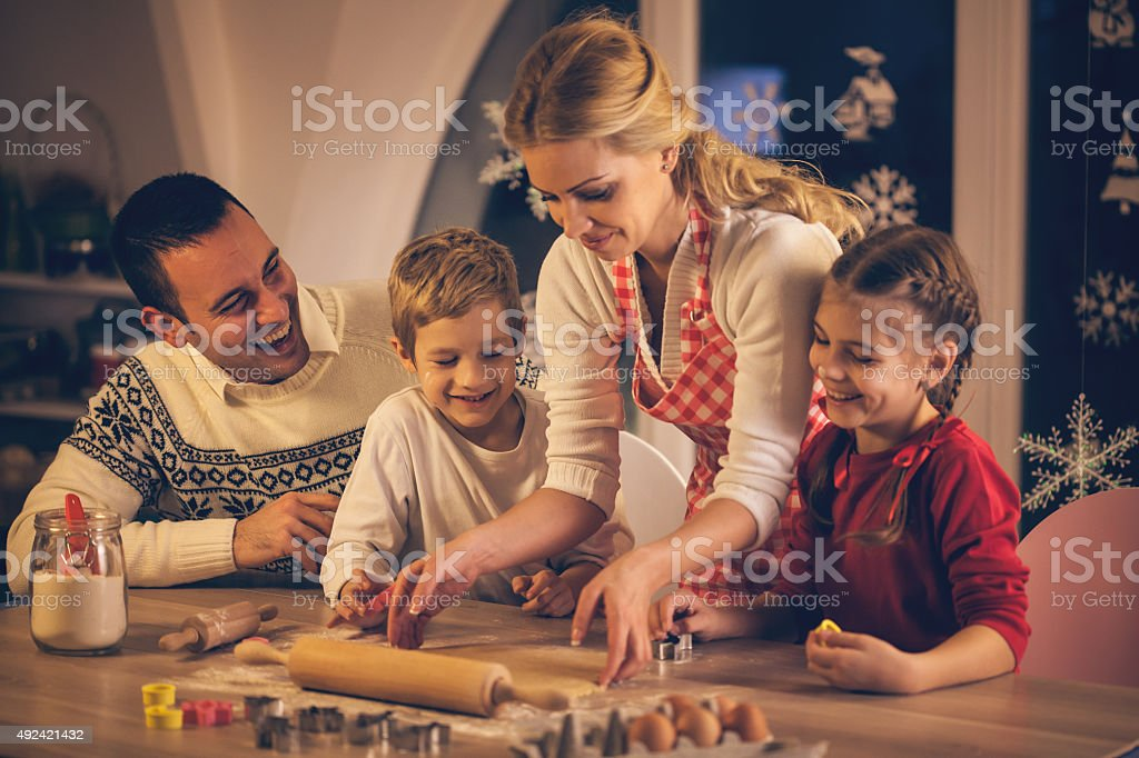 Family baking cookies for Christmas together stock photo
