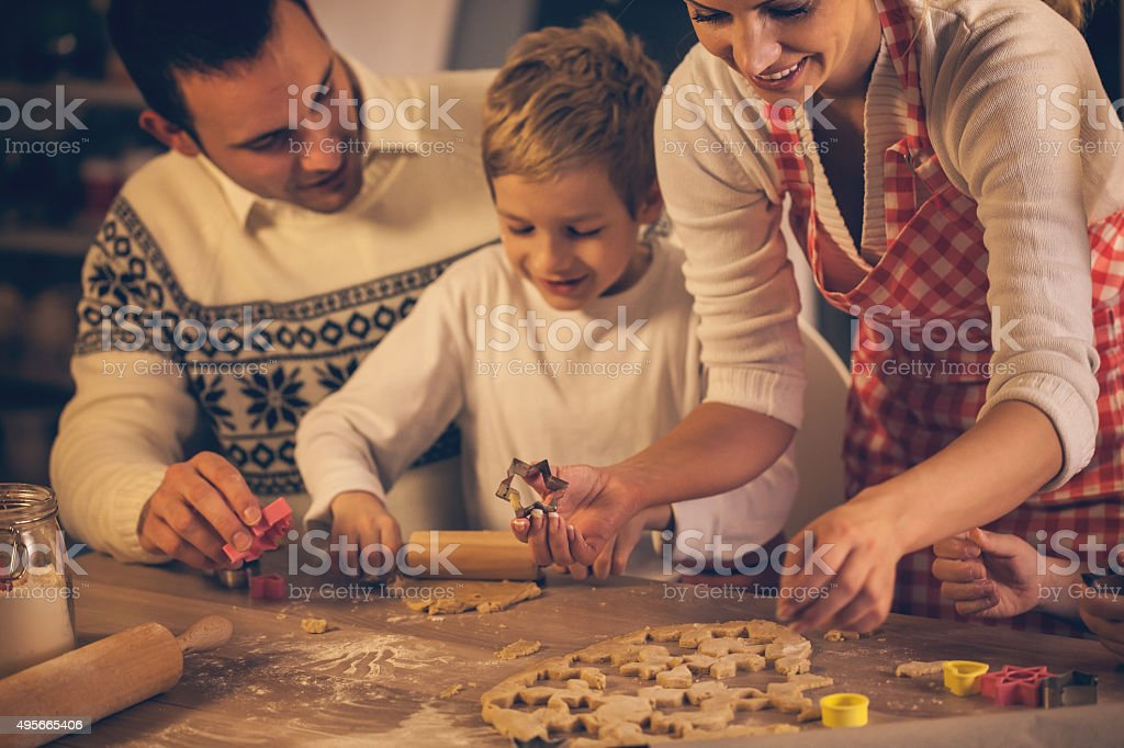 Family baking homemade cookies for Christmas stock photo