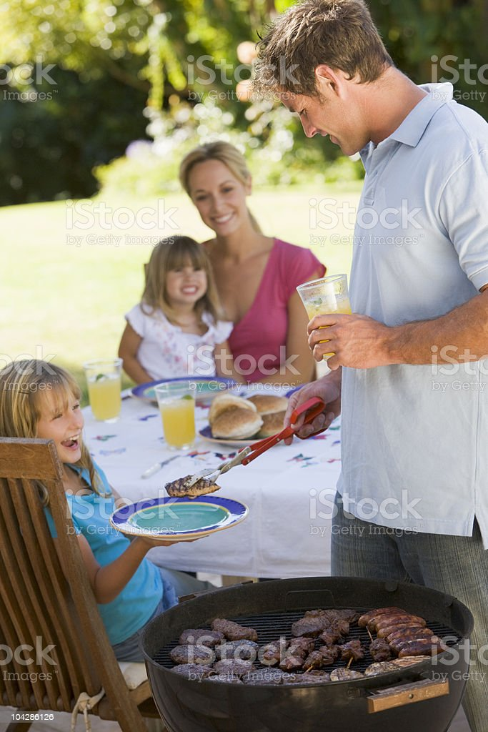 Family barbecue lunch on a beautiful Sunday afternoon royalty-free stock photo