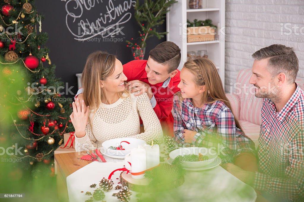 Family beside christmas table stock photo