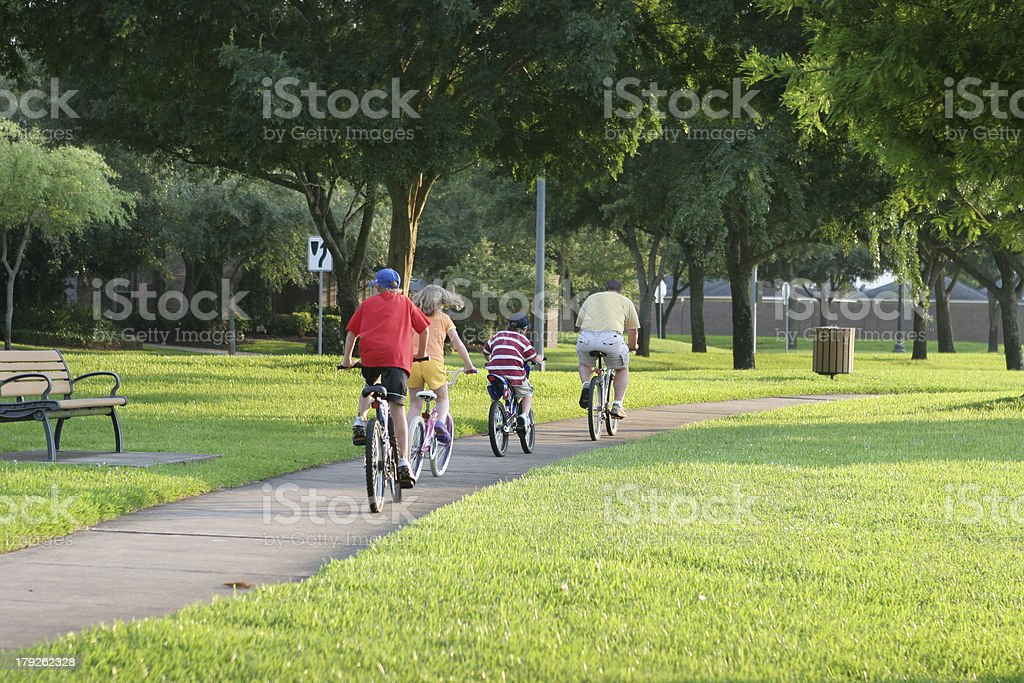Family biking together in a Sugar Land park, Texas stock photo