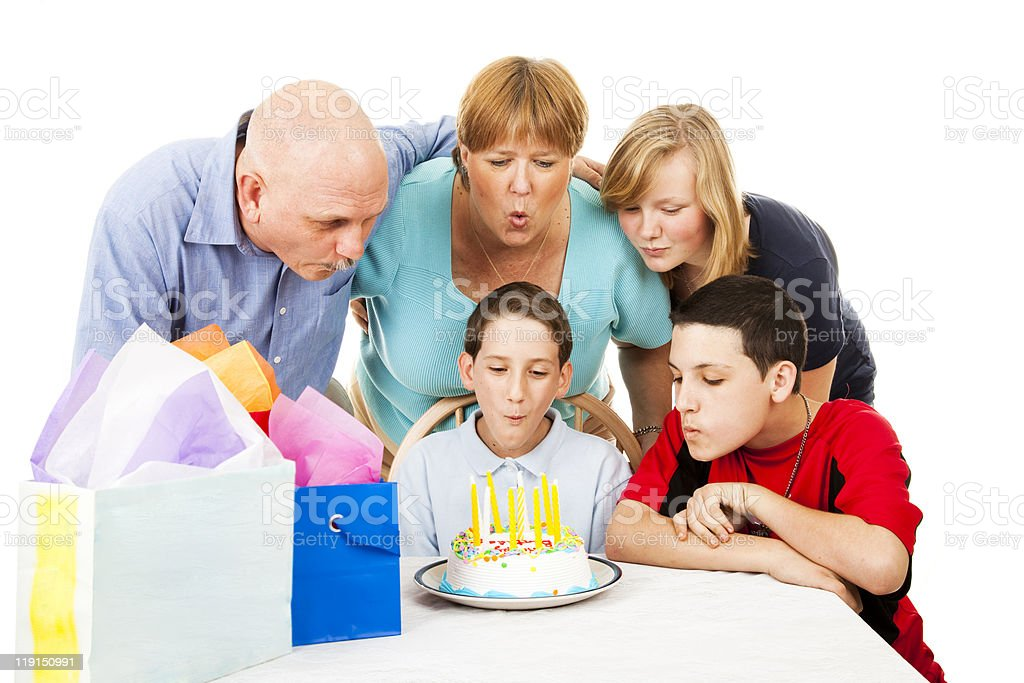 Family Blows Out Birthday Candles royalty-free stock photo
