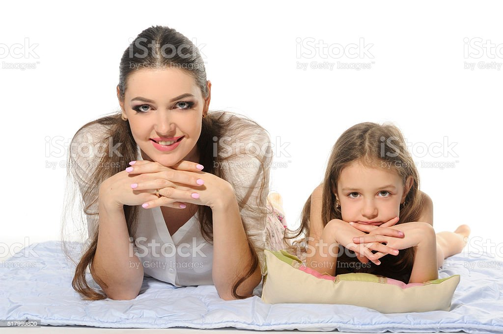 Family, blue blanket, his mother and her daughter, lying, laughing. stock photo