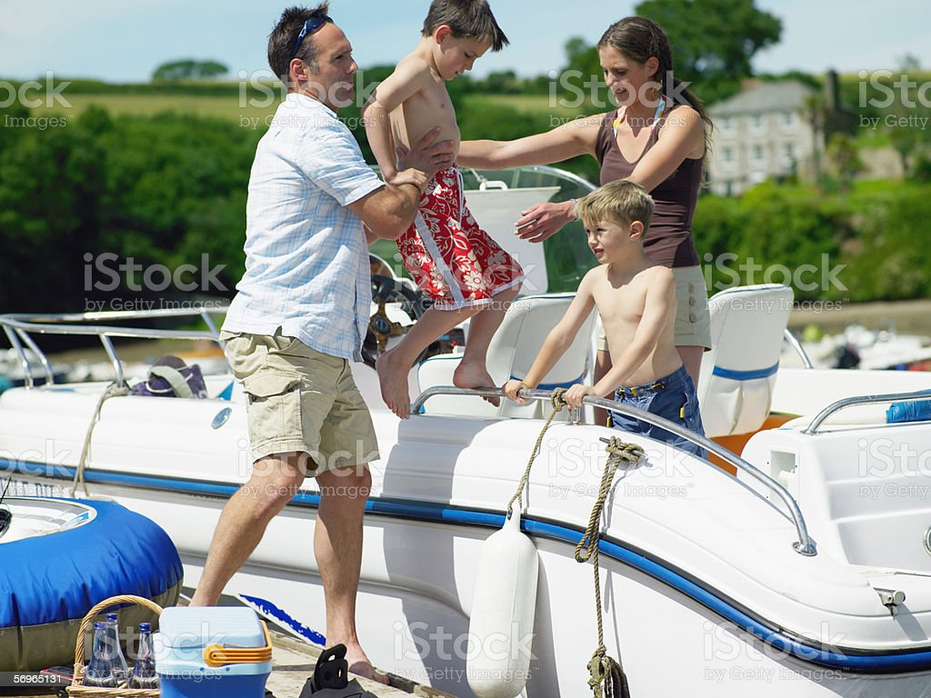 Family boarding motorboat stock photo