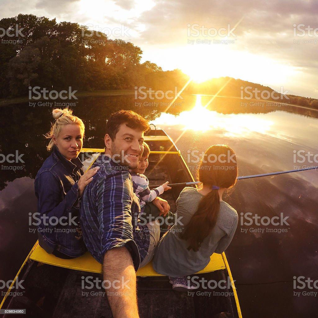 Family boat ride stock photo