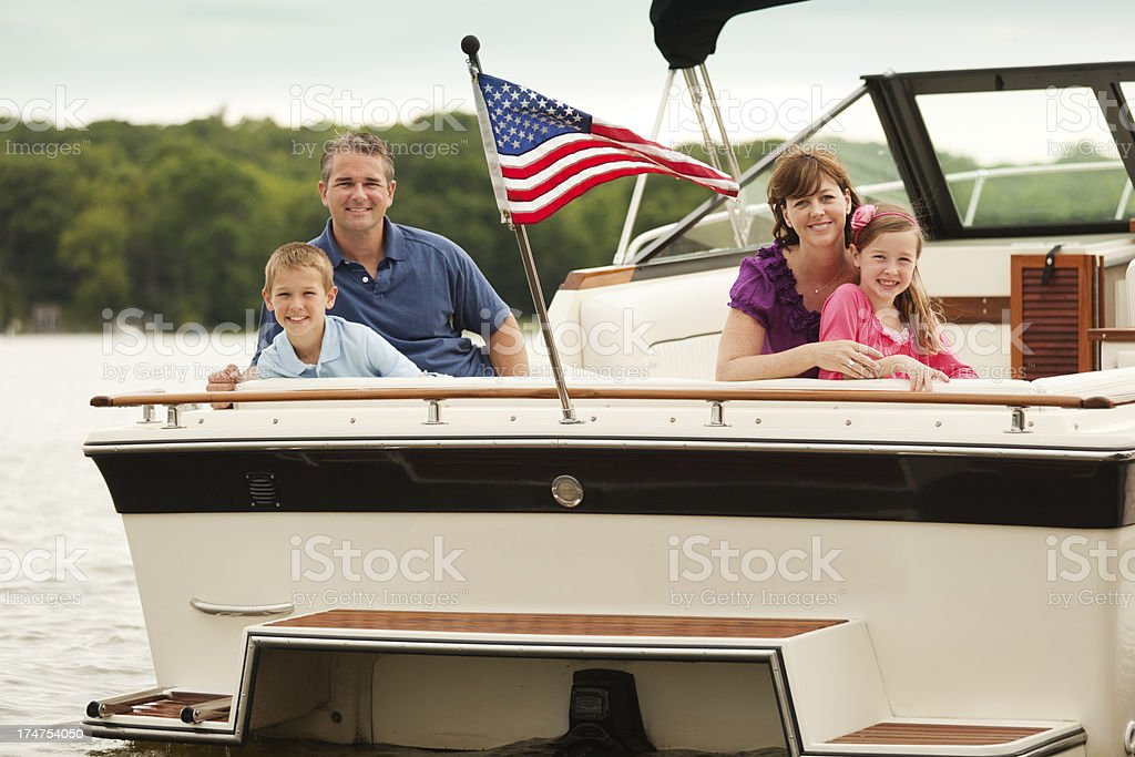 Family Boating on Lake stock photo
