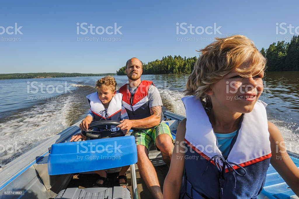 family boating together stock photo