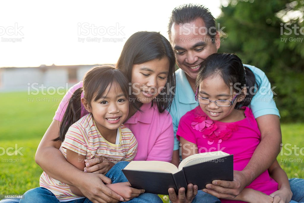 Family Book Study in the Park stock photo