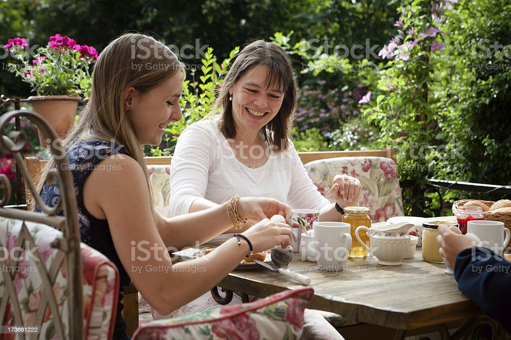 family brunch in a flowering garden royalty-free stock photo