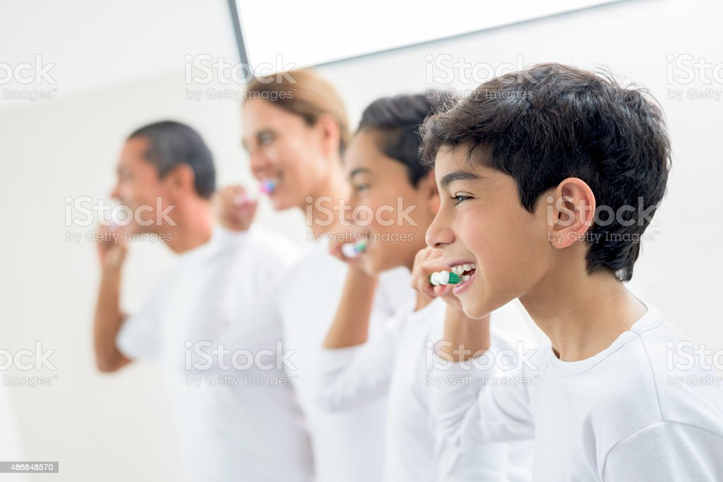 Family brushing their teeth stock photo