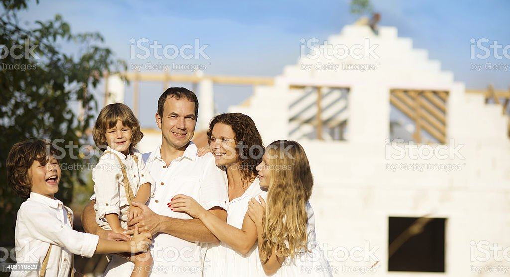 Family building a new house royalty-free stock photo