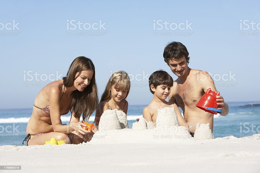 Family Building Sandcastles On Beach Holiday royalty-free stock photo