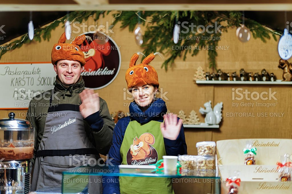 Family business of selling nuts at Vilnius Christmas Market stock photo