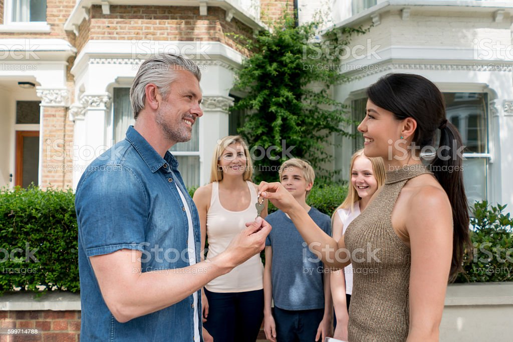 Family buying a house stock photo