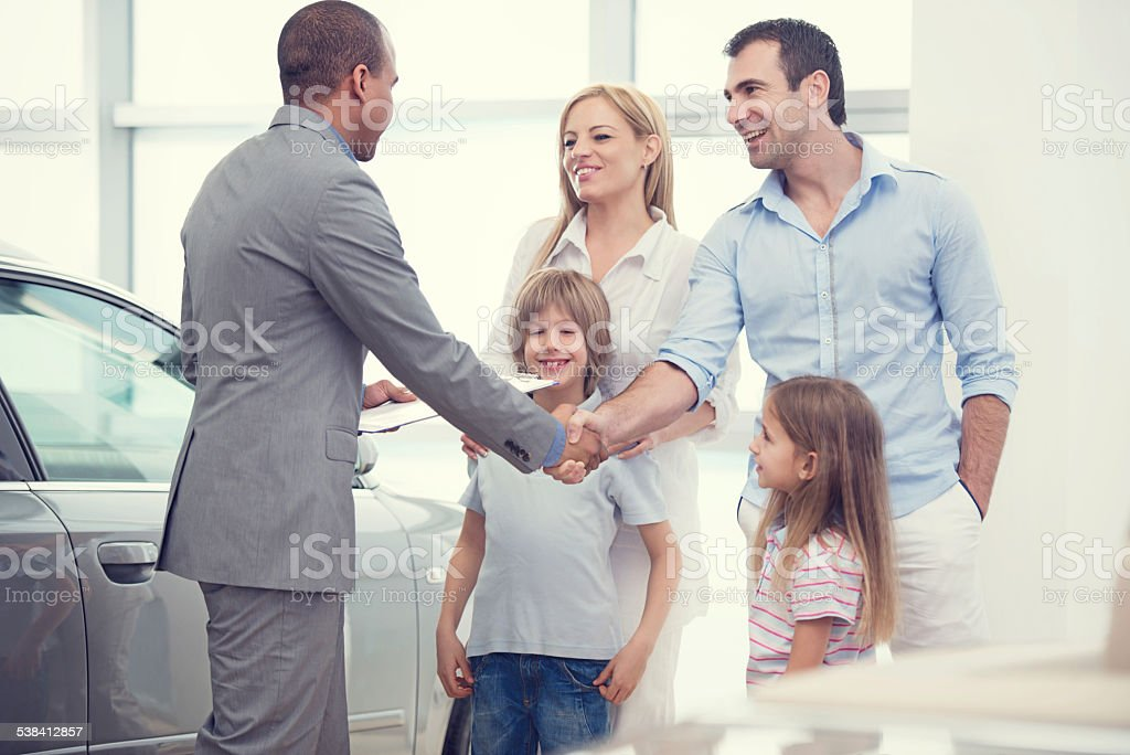 Family buying a new car. stock photo