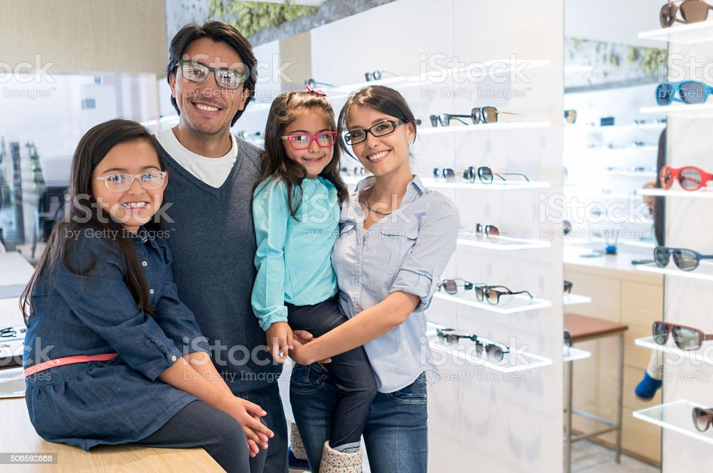 Family buying glasses at the optician stock photo