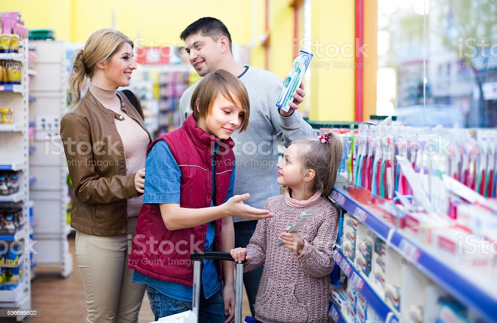 Family buying tooth-brush in supermarket stock photo