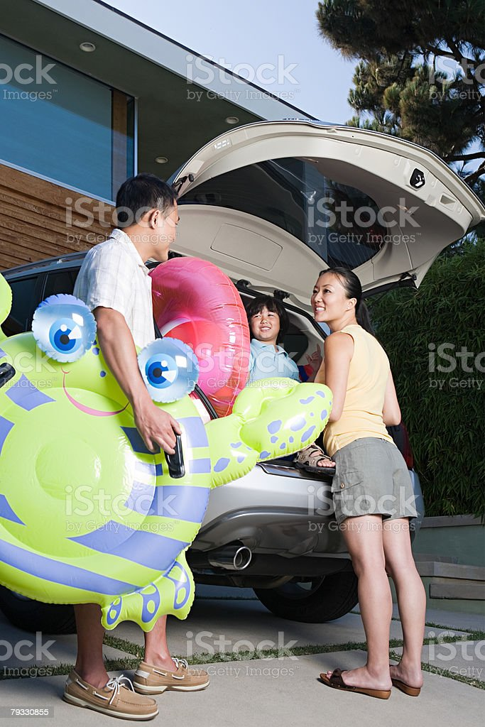 Family by car with inflatables royalty-free stock photo