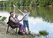 family camping and fishing, people active nature, child caught fish