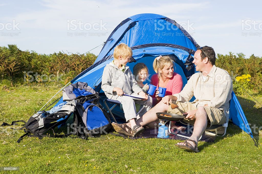 Family camping with tent cooking royalty-free stock photo