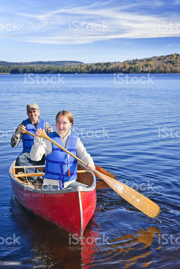 Family canoe trip stock photo