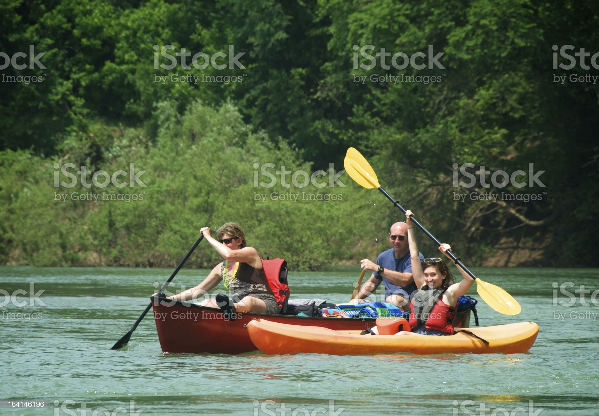 Family Canoeing and Kayaking Together royalty-free stock photo