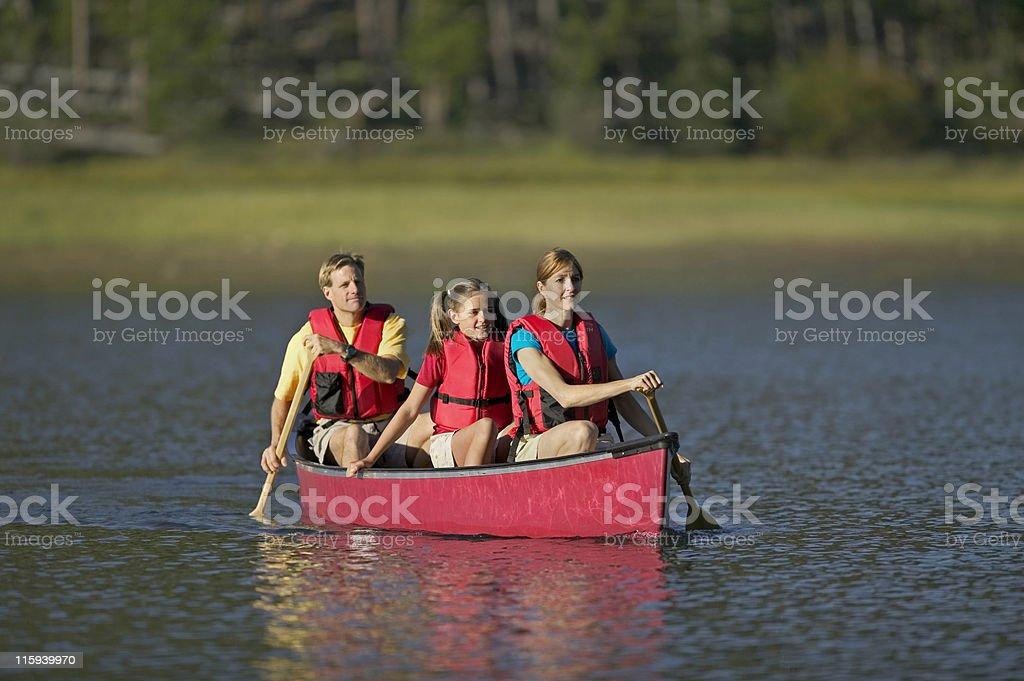Family Canoeing on Mountain Lake royalty-free stock photo