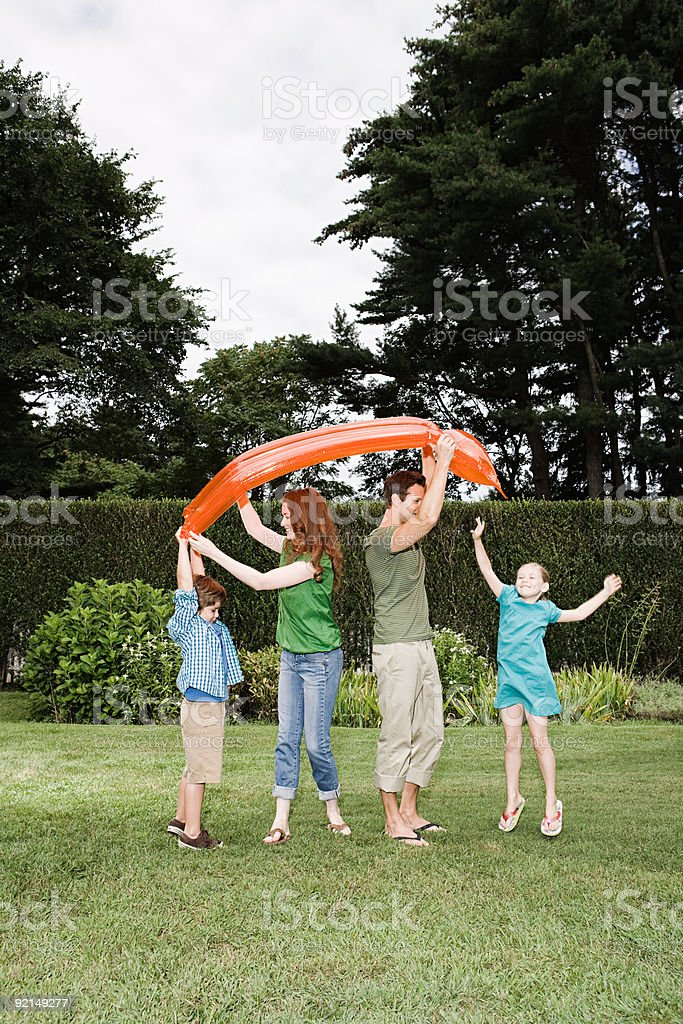 Family carrying an inflatable mattress royalty-free stock photo