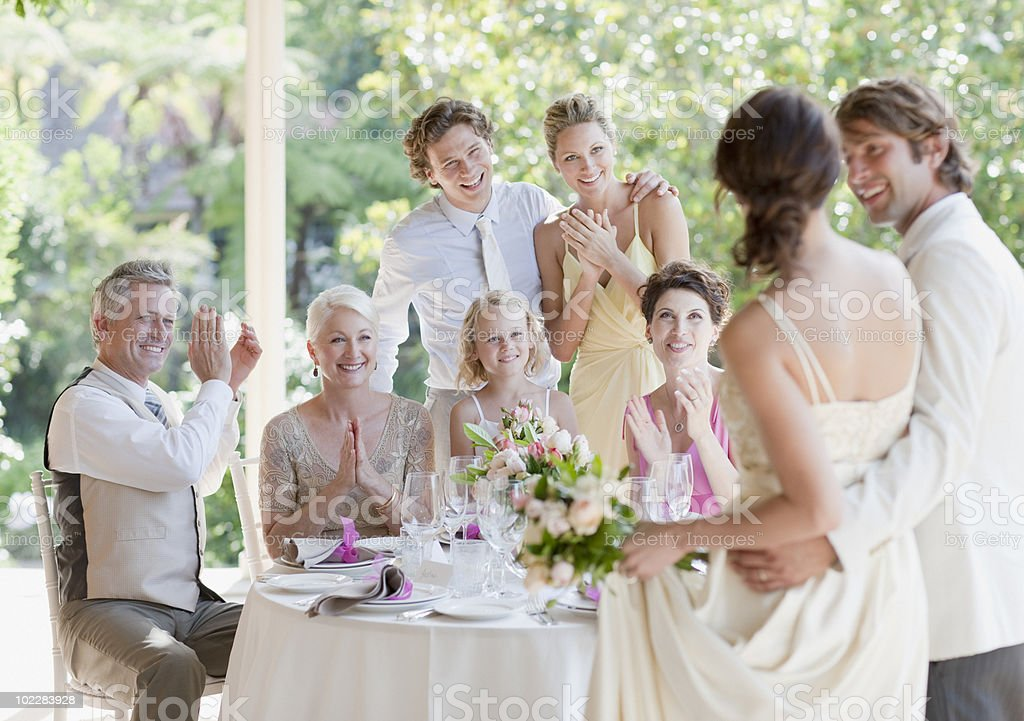 Family celebrating at wedding reception stock photo