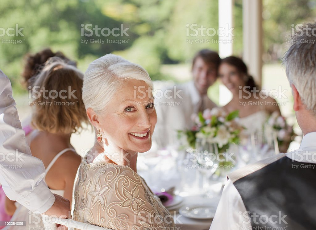 Family celebrating at wedding reception stock photo