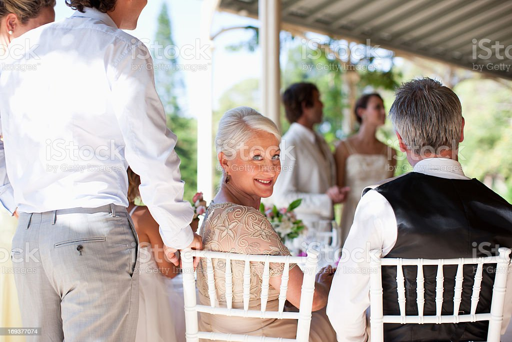 Family celebrating at wedding reception royalty-free stock photo
