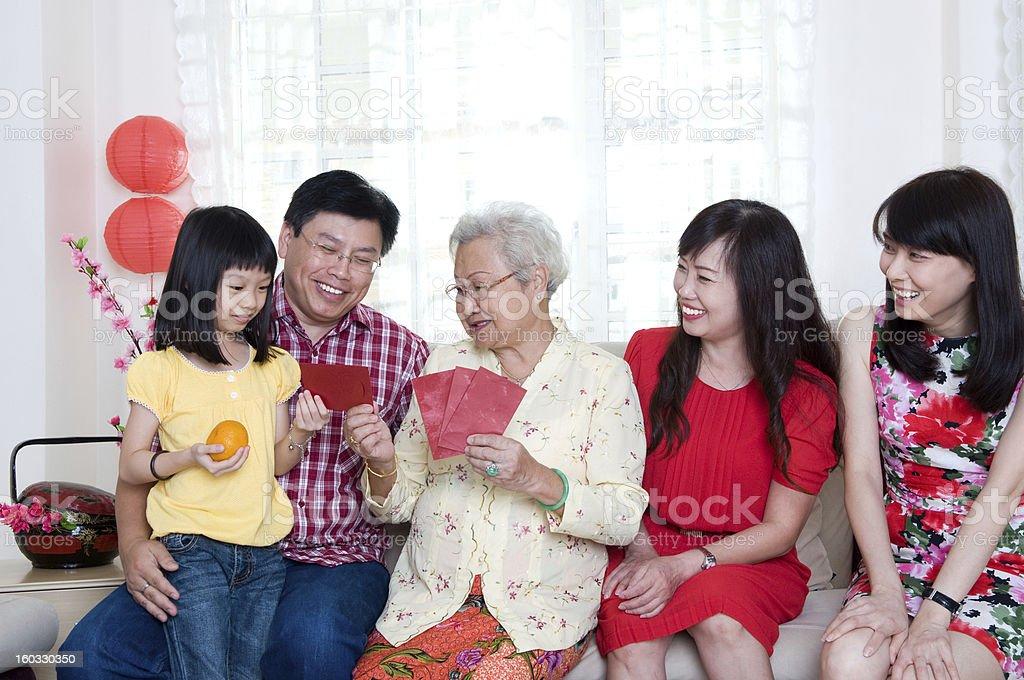 Family celebrating Chinese New Year stock photo