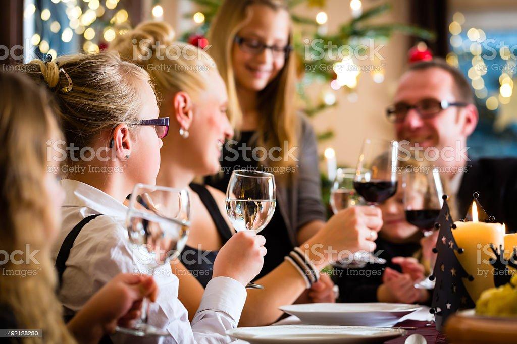 Family celebrating Christmas dinner stock photo