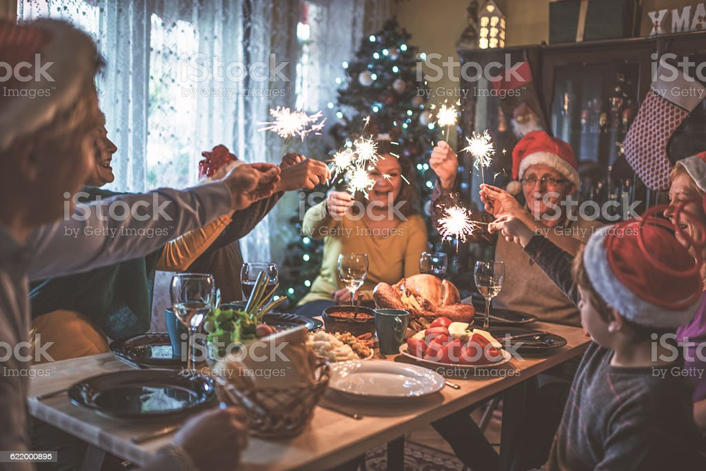 Family celebrating Christmas for many years together stock photo