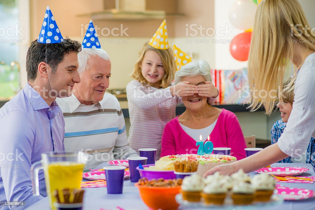 Family celebrating grandmother's birthday stock photo