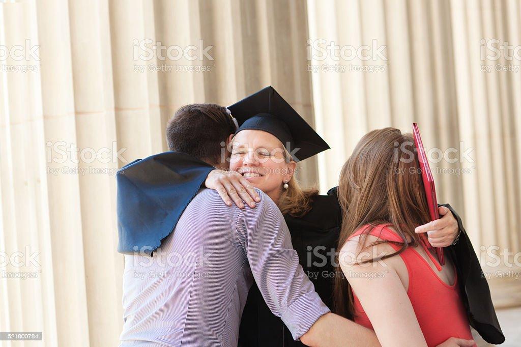Family Celebrating Mother's Graduation from University Higer Degree stock photo