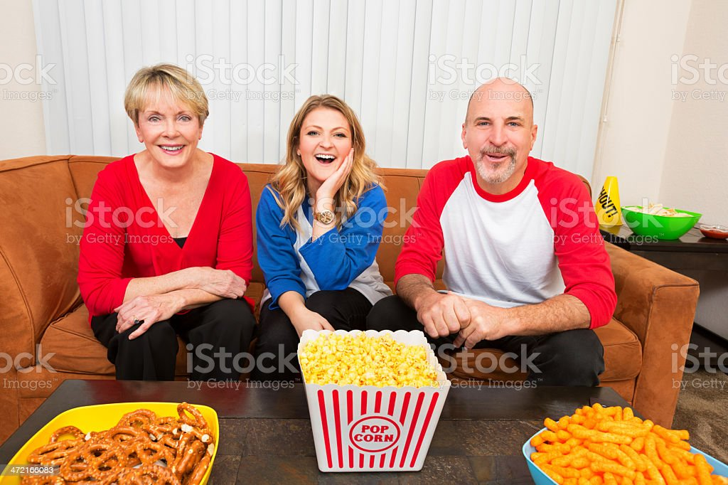 Family cheers for their team royalty-free stock photo