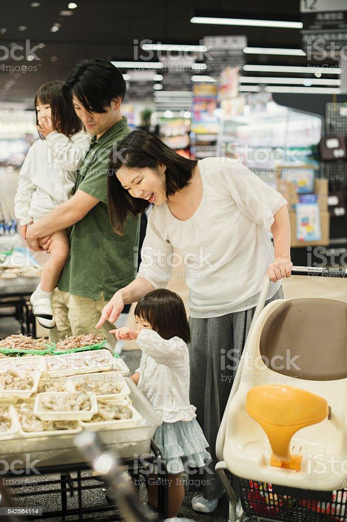 Family choosing fresh fish in fish department stock photo