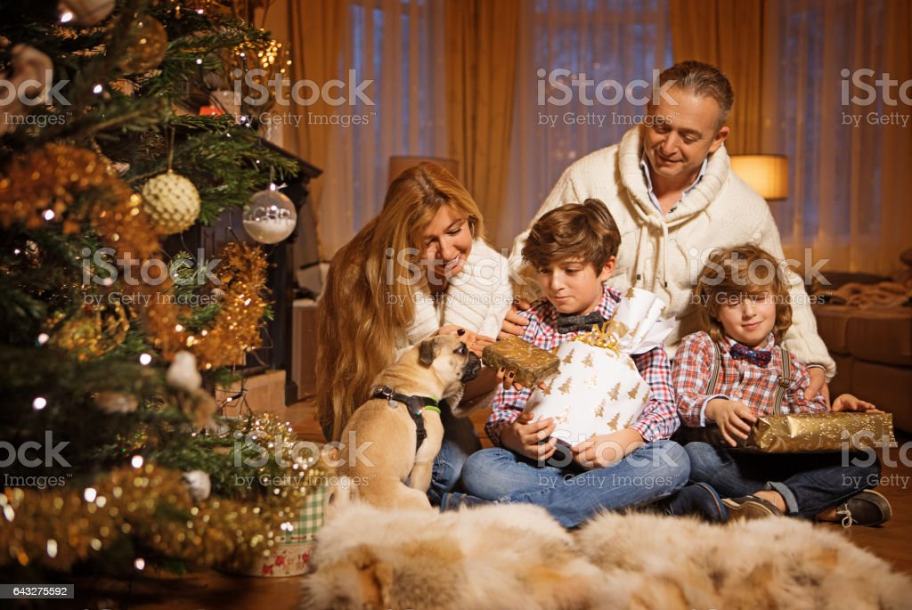 Family christmas scene with festive decorations in warm indoor setting stock photo