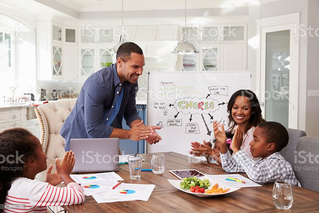 Family clapping at a domestic meeting in their kitchen stock photo